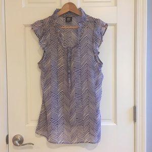 Sweet sheer sleeveless blouse with ruffle detail